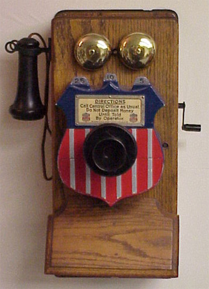 Gray Telephone and Pay Station -